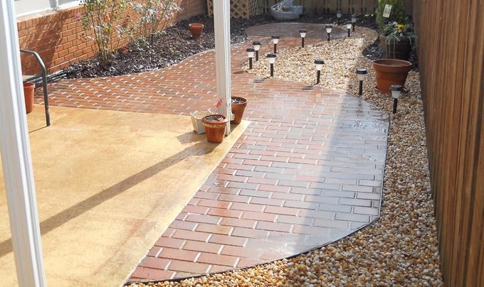 curved concrete paver patio hardscape feature