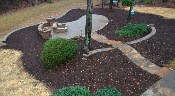 large paver patio seat wall and fire pit