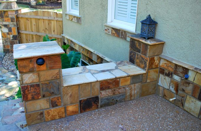 exposed aggregate patio with rock seat wall hardscape feature