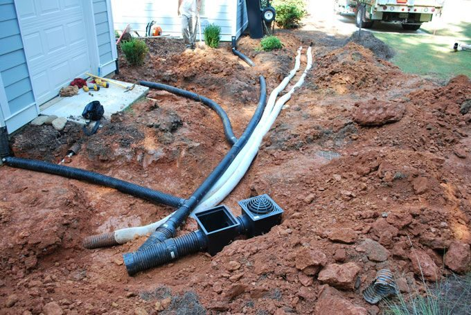 downspout drains and yard drains installed by landscaper
