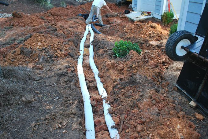 french drains installed to keep landscaping draining properly