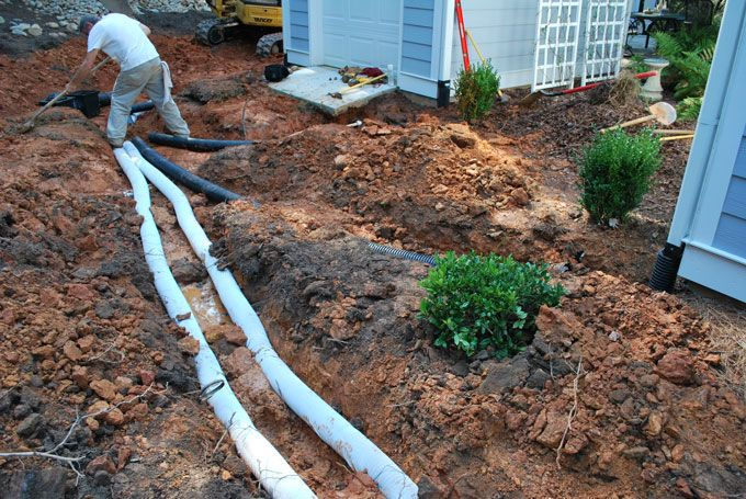 french drain system designed by fayetteville landscaper