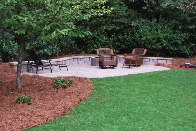 simple paver patio, seat wall, and fire pit