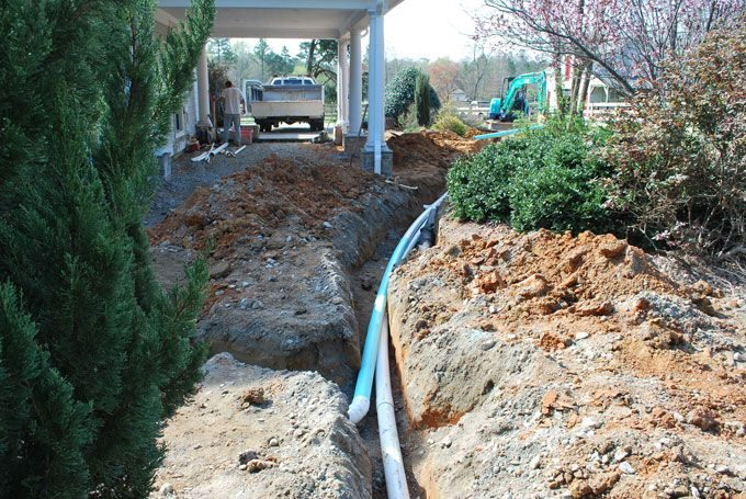 """4"""" downs pout drains installed by fayetteville landscaper"""