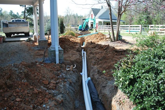 down spout drain systems and absorbing french drain sytems