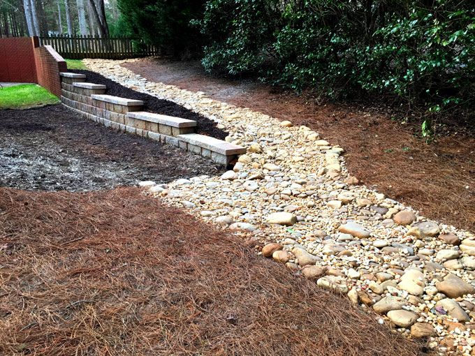 dry creek bed and extended retaining wall