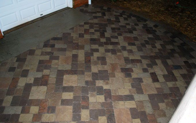 multicolor paver patio using 4 sizes of pavers
