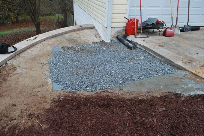 large catch basin from rubber liner and gravel behind retaining wall