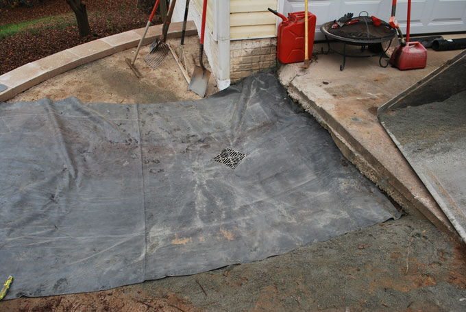 creating a large catch basin behind a retaining wall