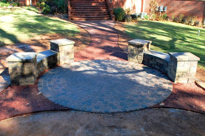 circular paver patio with block benches