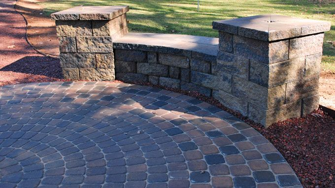 circular paver patio with seat wall and columns hardscape featureu