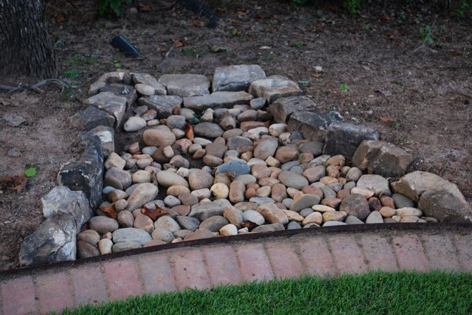 use river rock to slow water and stop erosion