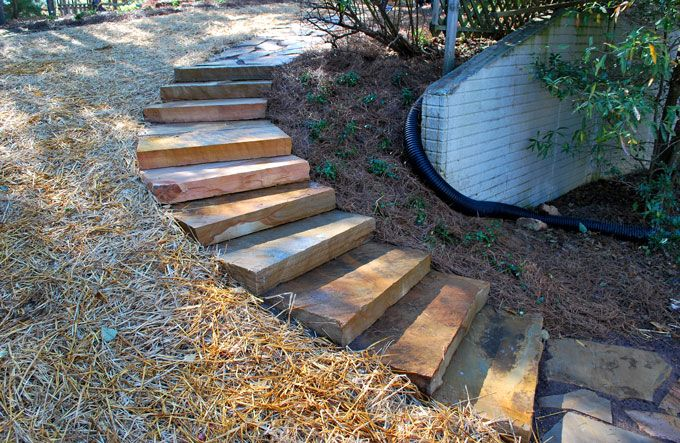 landscaping staircase using large rock slabs