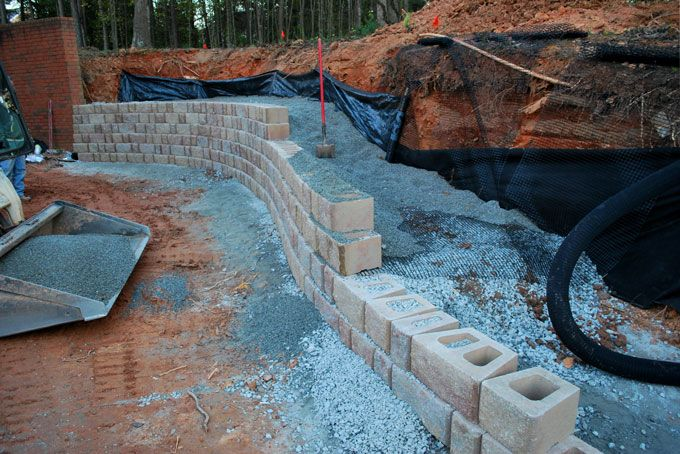 goe grid, drain pipe, filter fabric in retaining wall construction