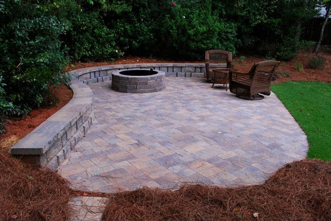 back yard hardscape feature with retaining wall blocks and pavers to match