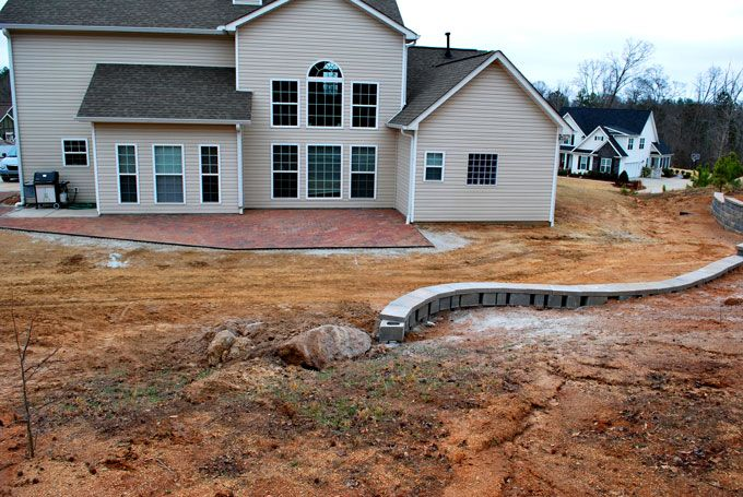 ending a retaining wall with boulders
