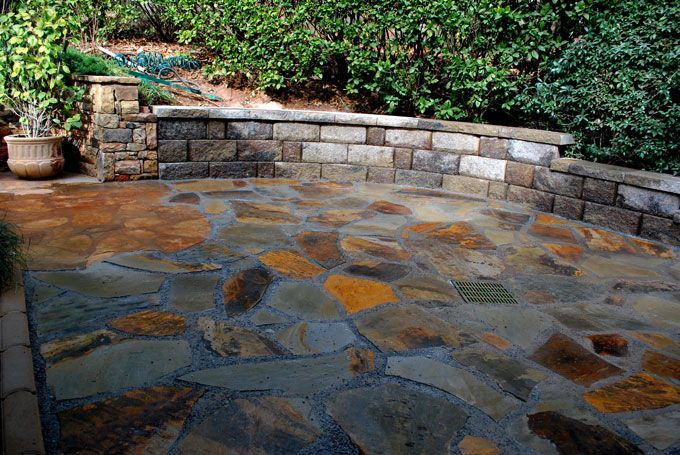 stone slab patio and bench wall