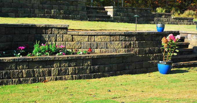steps and planter boxes built into large retaining wall