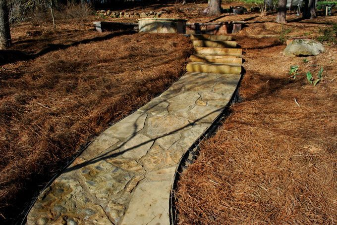 peachtree city landscaper creates sloped flagstone sidewalk