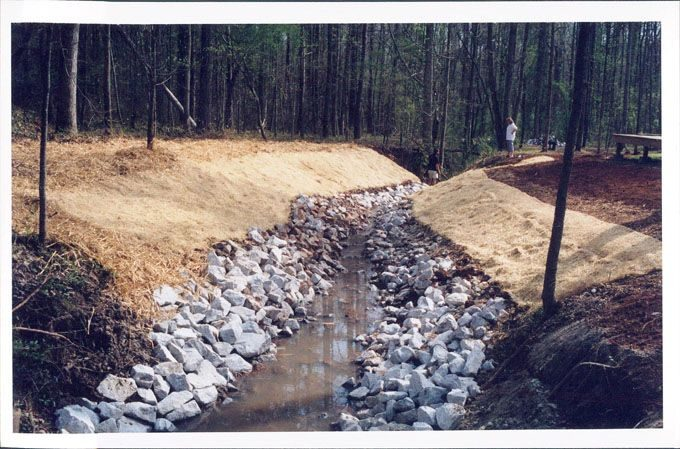 rock lined creekbed stops erosion