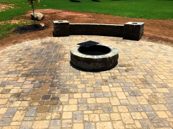 fire pit, bench with columns paver patio