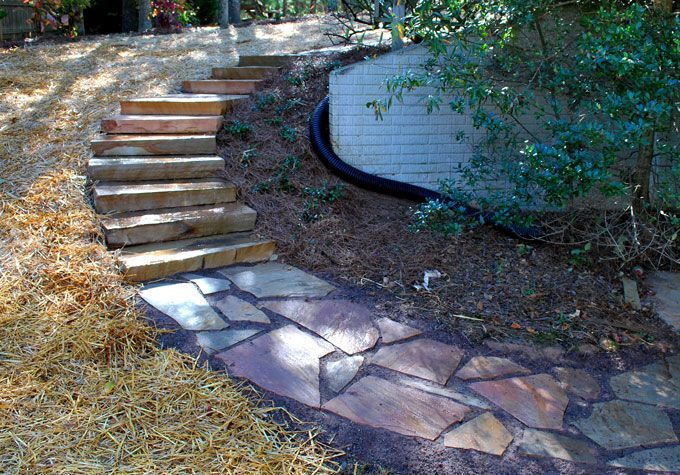 landscaper in tyrone uses natural rock slabs to create garden stairs