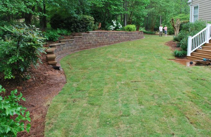 professional landscapers in peachtree city installing zoysia sod