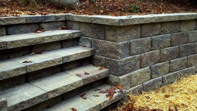 pavestone retaining wall corner blocks installed by fayetteville landscaper